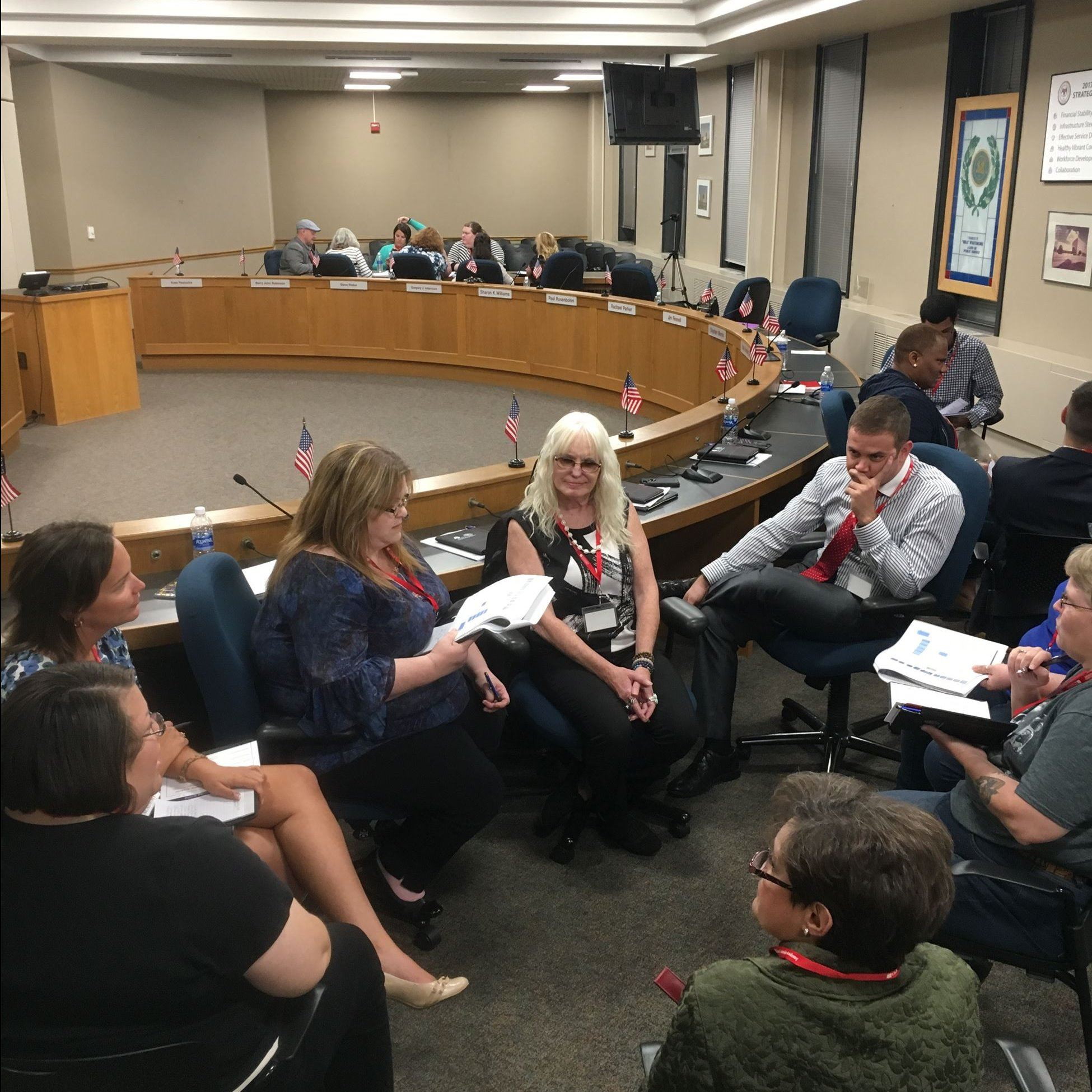 Citiznes Leadership Academy participants discussing in board room.
